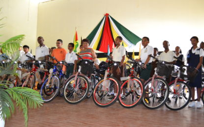124 top NGSA students receive bicycles and backpacks – Minister Ally praises their success