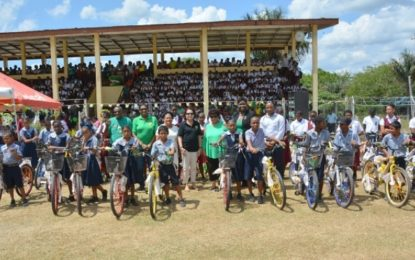 Minister Ally, First Lady distribute 50 bicycles, 400 pairs of shoes to Kwakwani students  –under the 'Five Bs' programme