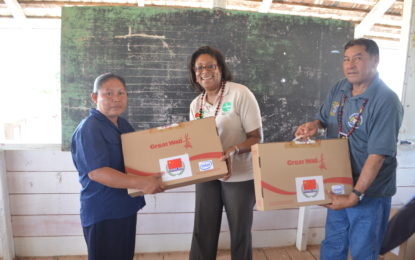 Ministers Sydney Allicock and Catherine Hughes in Lethem distributing OLPT