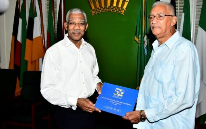 President receives book chronicling history of his alma mater