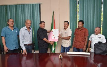 Kariako receives land title document