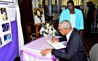 President signs condolence book for the late Ms. Carmen Jarvis
