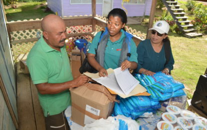 Minister Hastings-Williams delivers flood relief  to hometown in Region Seven