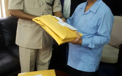 Handing over of Forensic Audit Reports for National Insurance Scheme (NIS), National Drainage and Irrigation Authority(NDIA), Guyana Lotteries Committee, Scrap Metal Unit, Central Housing and Planning Authority(CH&PA) and the Ministry of Home Affairs' Purchase of a Water Cannon to Commissioner of Police.