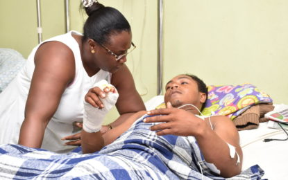 Minister Broomes visits miner injured during robbery in interior