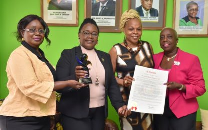Min Broomes cops US award for empowering women and girls