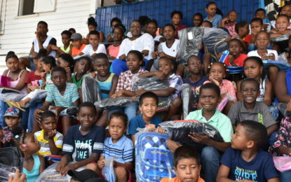 Min Broomes honours commitment with wheelchair donation to Bartica resident