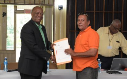 Region Ten residents receive land titles after 25-year long wait