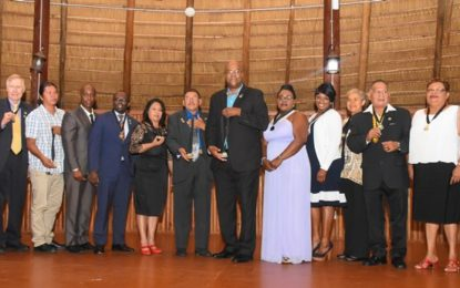 Ten receive global humanitarian award named after Minister Allicock