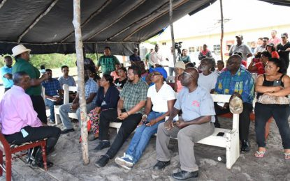 Min. Broomes mediates solution between Moblissa residents and loam mining contractor