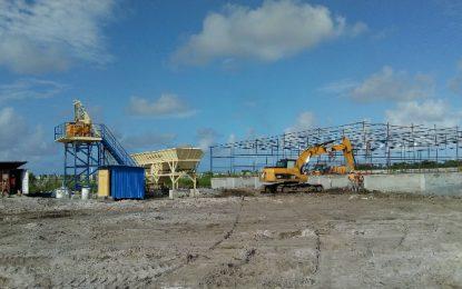 East Coast Road Project progressing; concrete, asphalt plant arrive