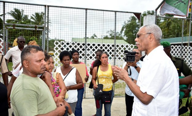 President meets with laid off security guards at New Amsterdam