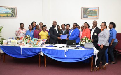 National Library receives laptop, book donations from Pele FC Alumni