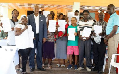 'We will right the wrongs done to this community'  -Minister Harmon tells Mocha as 54 residents receive Titles to lands