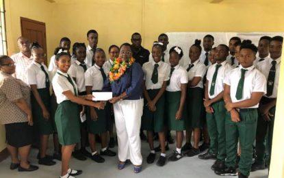 Mackenzie High students get monetary donation for graduation