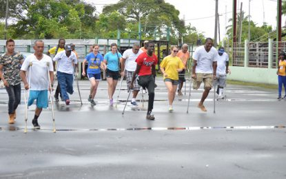 Persons with Disabilities brave rain for Day of Sports