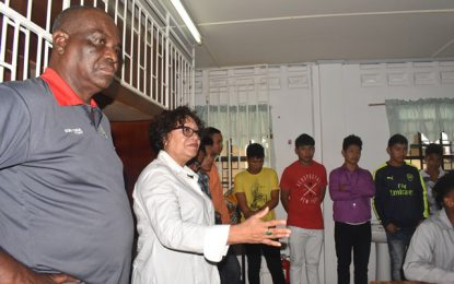 Minister Garrido-Lowe interacts with students from ETI dormitory