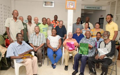 Min. Broomes honours fathers of St Thomas More Men's Home