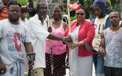 Minister of Health donates tools to Rasville residents to aid in clean-up exercise