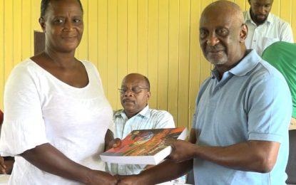 Govt donates books, sporting gear to Baracara residents