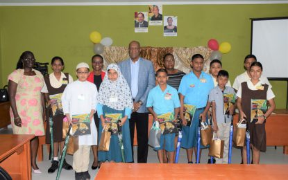 ICT Developments in Region Three's education sector highlighted as Minister Joseph Harmon congratulates top NGSA students