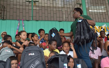 Minister Broomes donates school supplies to Bartica students