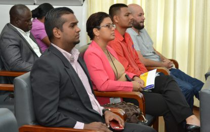 Stakeholders connect at telecommunications symposium