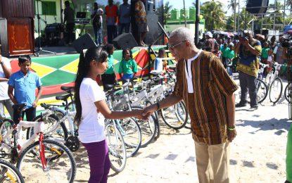 President donates 25 bicycles to children along East Corentyne Berbice