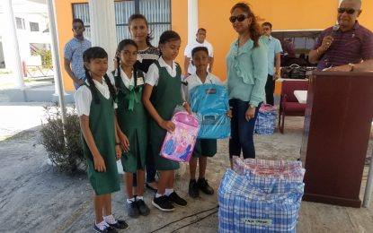 Region Three Admin and 'Back-to-School Backpack Drive' outfitting students