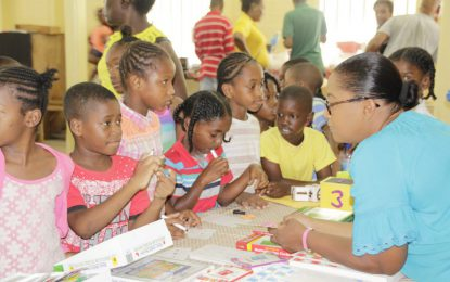 Albouystown, Charlestown youths benefit from literacy outreach