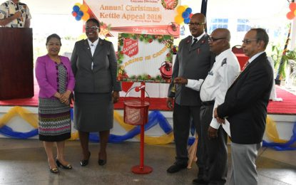 Minister of Public Affairs donates to Salvation Army Christmas Kettle drive