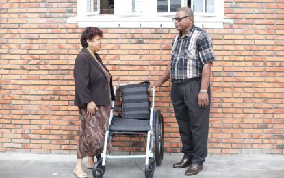 Elderly citizen receives new wheelchair