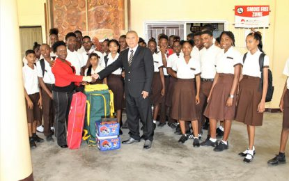 Minister Norton makes timely donation of cricket gear to Tutorial High School