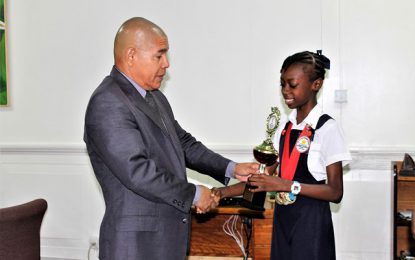 Gold-medalist Tianna Springer thanks Minister Norton