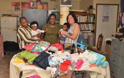 First Lady presents clothing and other items to WAD