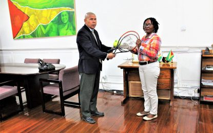 Parika youth group receives racquets from Min. Norton