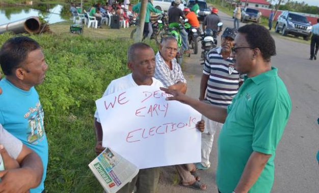 AG Williams engages opposition protestors, addresses their issues